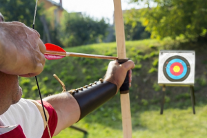 When should you carry arrows in the nocked position